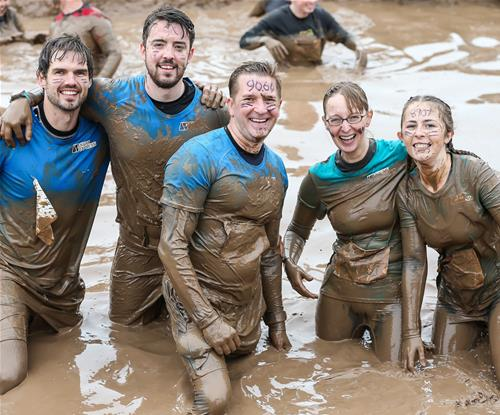 The team at Signs Express Birmingham on a muddy team building day