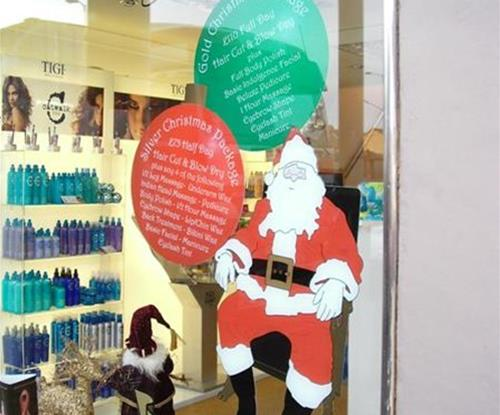 Exterior Shop Window Christmas Signage by Signs Express