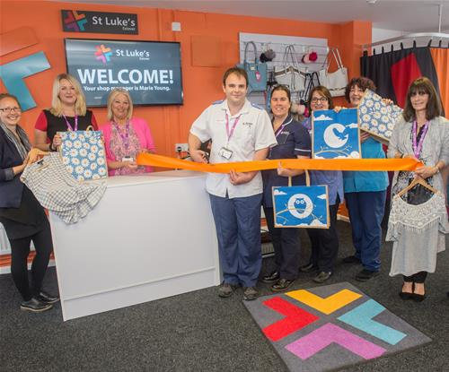 Staff enjoying the new internal signage at one of St Luke's Hospice charity shops