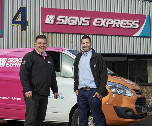 Craig Brown (left) with Ben Walker (right) outside Signs Express Bristol