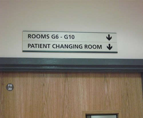 Interior wayfinding signage at Roundwell Medical Centre