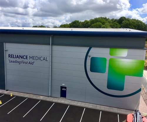 Reliance Medical Logo and Tagline on the Building