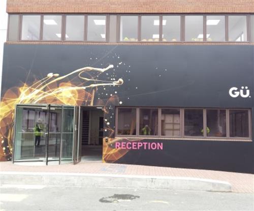 Main office reception fascia incoporating 'explosion' graphics