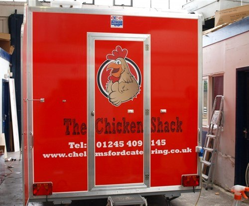Side of trailer logos and text fitted around door
