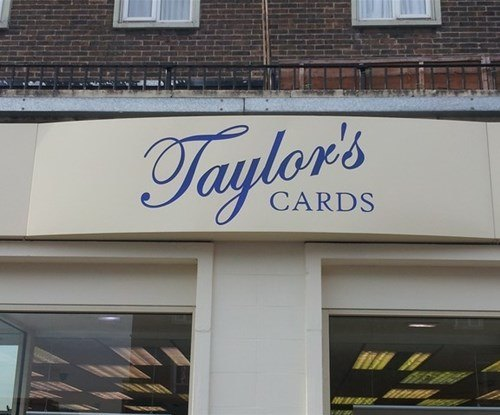 Powder coated aluminium fascia installed at Taylor's Cards shop in Debden