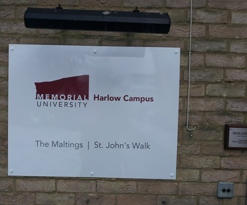 Wall mounted aluminium sign for the Harlow Campus of Memorial University