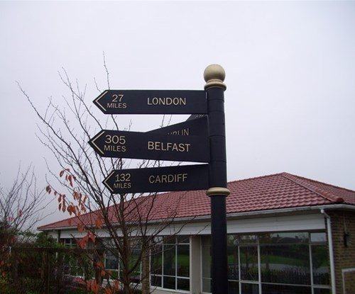 Directional fingerpost indicating worldwide capital cities for an educational project within Hare Street Primary School in Harlow
