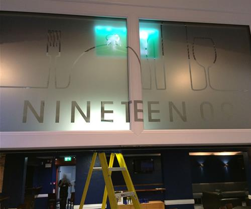 Refurbished the dining area: window etch was applied to the windows and bar