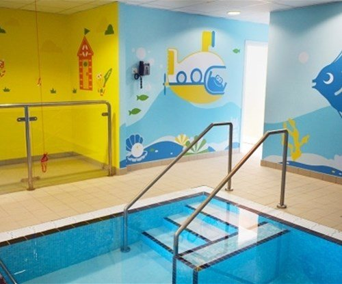 Interior wall graphics for a swimming pool