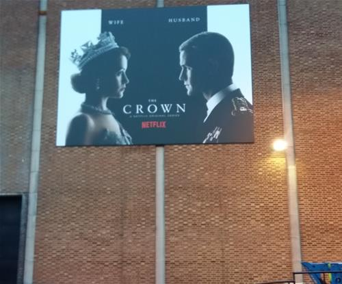 Flex-face sign advertises 'The Crown'