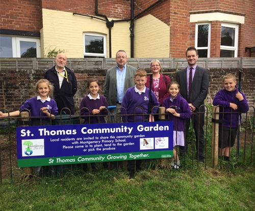 Pupils and teachers from the school with Nick and Marion Baxter-Sibley and their new sign