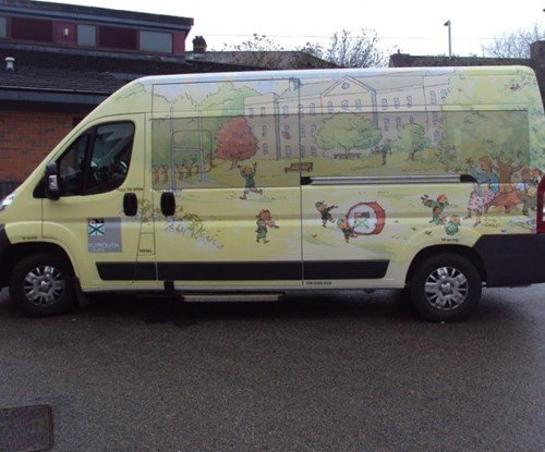 Local Sign Makers Work with Award Winning Author to 'Prep' a School Minibus.