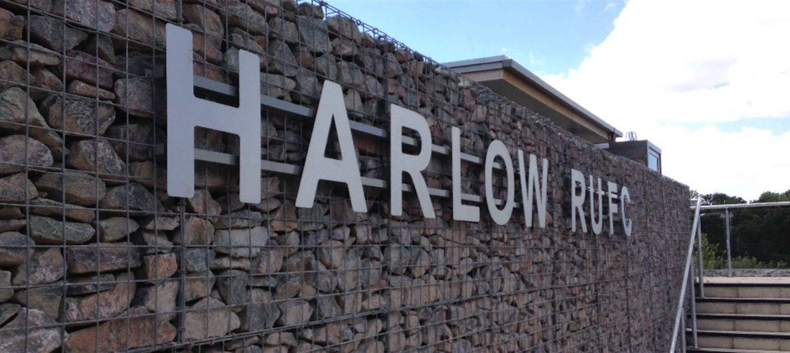 Stainless Steel lettering fixed to Gabion wall