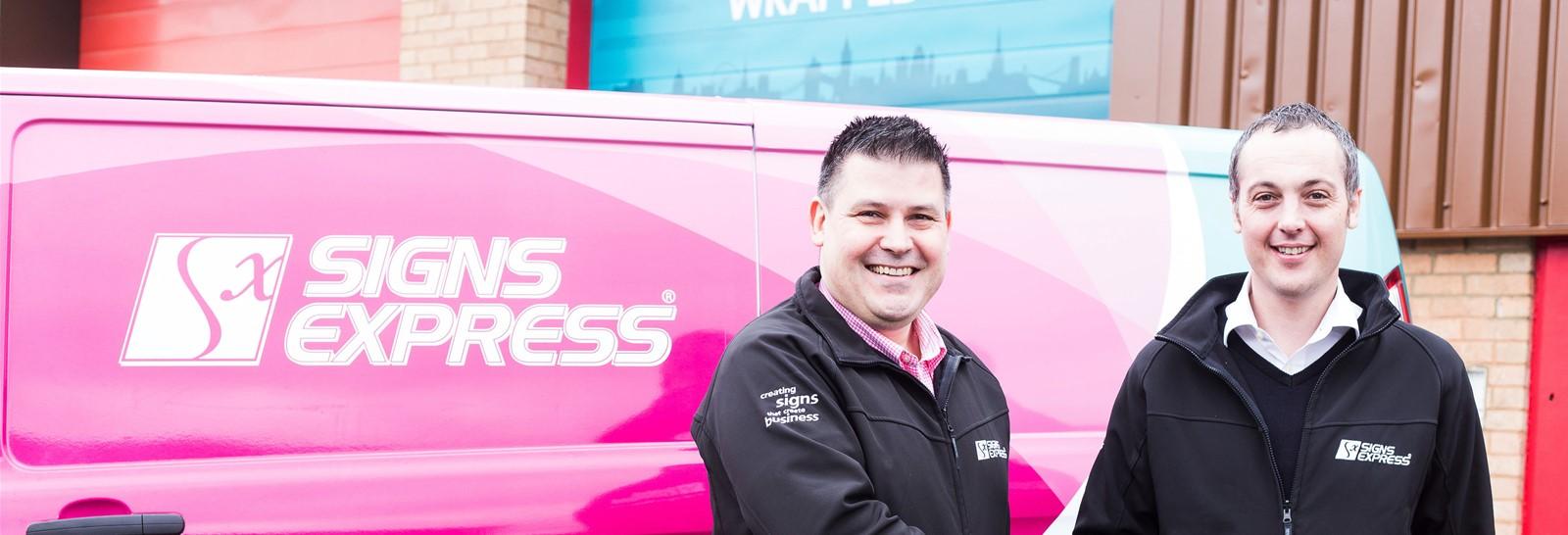 Craig Brown congratulates David Halliday on becoming a Signs Express Franchisee