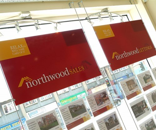 Cable and rod window display systems in Northwood UK shop window