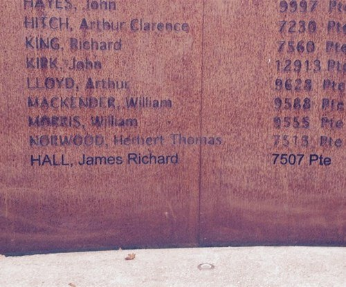 The addition of the name of a WWI soldier on a metal memorial in Worcester