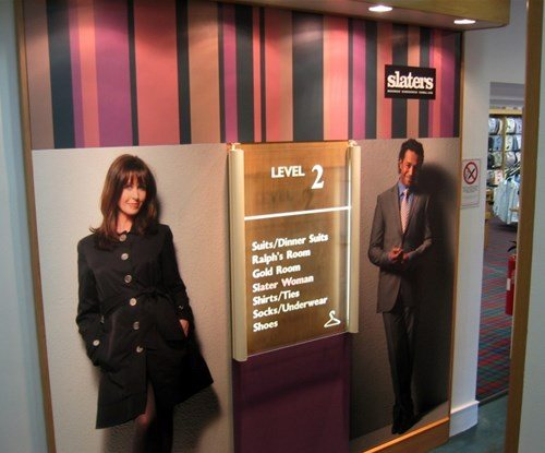 Interior large format printed shop graphics and acrylic directory sign for Slaters