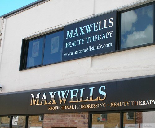 Maxwells Hairdressing panel shop sign