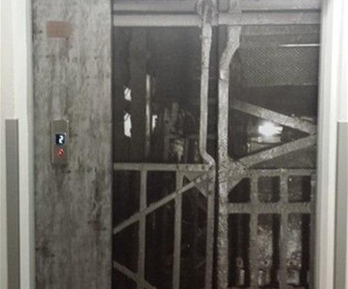 Printed vinyl graphics for lift face depicting mine shaft lift entrance
