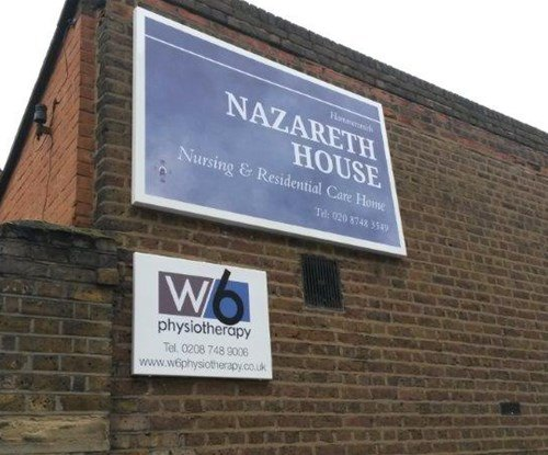 Wall mounted tray sign for Nazareth house