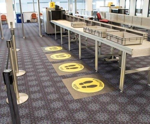 Floor graphics help passengers get on their journey