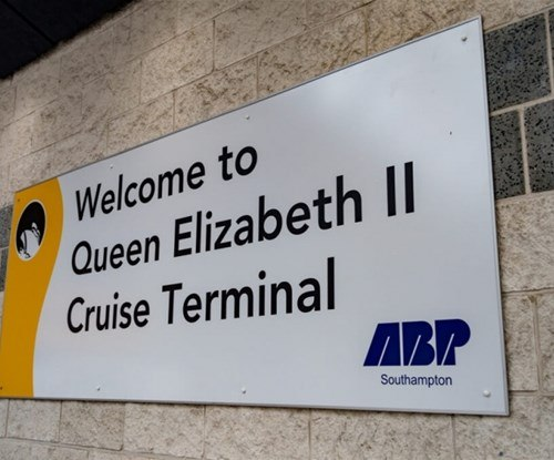 Internal signage welcomes passengers from around the globe