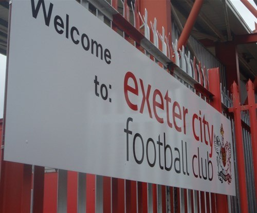 Exeter City Football Club welcome panel entrance sign attached to railings