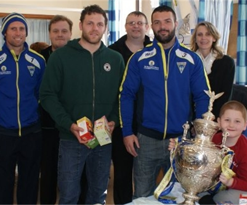 Signs Express (Warrington) joined by the members of the Warrington Wolves Rugby team