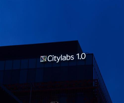 Manchester's Citylabs 1.0 sign brightens up the skyline at night