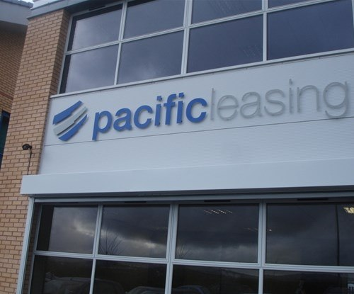 Exterior building signage using fret-cut dibond with vinyl applied to face, stand-off lettering