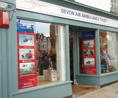 Window graphic displays completed at twelve shops in Devon.