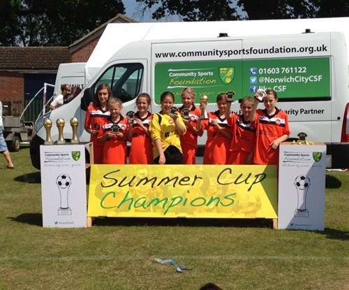 Sprowston Girls FC with their winning trophies