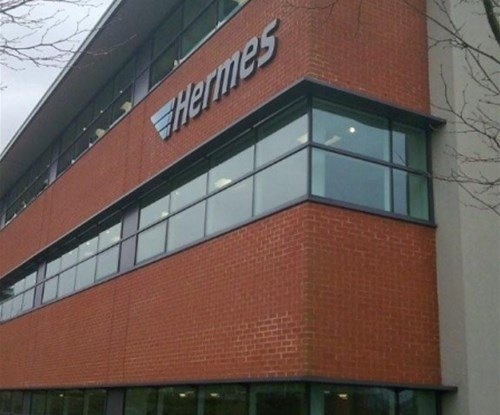 HERMES corporate re-brand exterior building sign