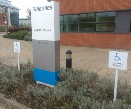 Exterior monolith sign and disabled parking signs
