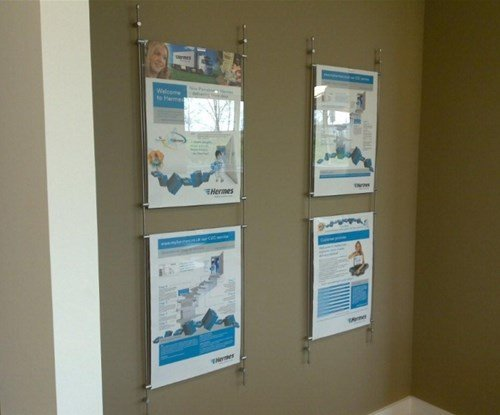 Wall mounted internal rod display system with acrylic pockets.