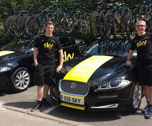 Signs Express (Manchester) Director Lee Eaton and sign maker Aaron Johnson after completing the striking yellow liveries