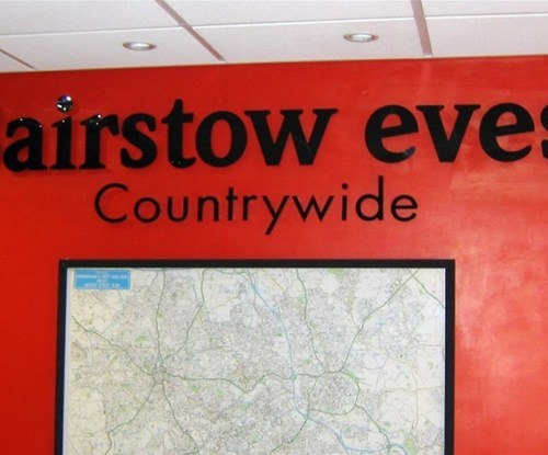 Internal sign in Bairstow Eves corporate style