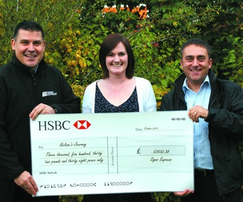 Craig Brown and Paul Baldwin of Signs Express with Sophie Berry