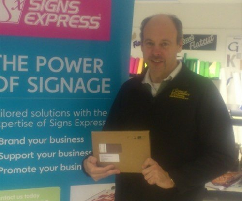 Mark Bone BSc, Development Manager for Vale Of Aylesbury Housing Trust with his prize of Tea for Two.