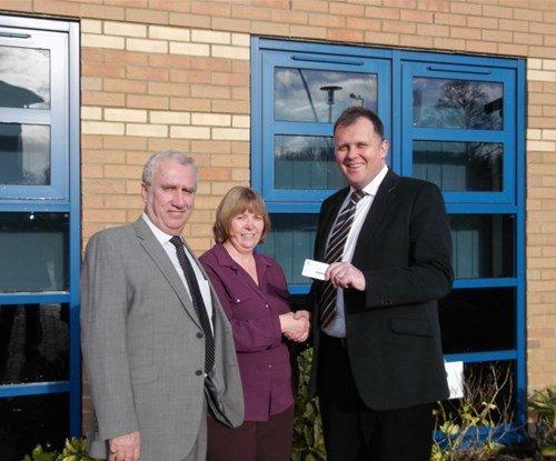 Gail receiving her National Trust membership from Mark Meadowcroft