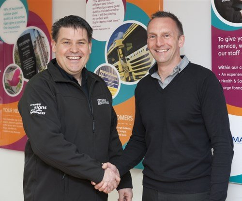 Signs Express managing director Craig Brown with Norwich franchisee Ken Venables