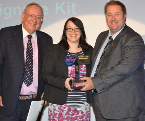 Rebecca Dack presents the award to Kevin Batham from Zeta Specialist lighting (R)