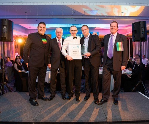 Lee Eaton of Signs Express (Manchester) accepting his award from the company directors