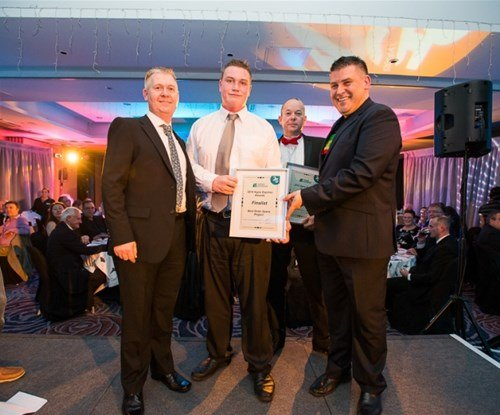 Rick and Dave Nurse receiving their award from managing director Craig Brown
