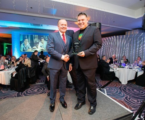 Graham Casey of Signs Express Glasgow accepting his award from managing director Craig Brown