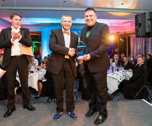 Ian Charles of Signs Express Grantham accepting his award from managing director Craig Brown
