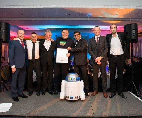 Jay Patel (third from right) accepting his finalist award from Signs Express managing director Craig Brown