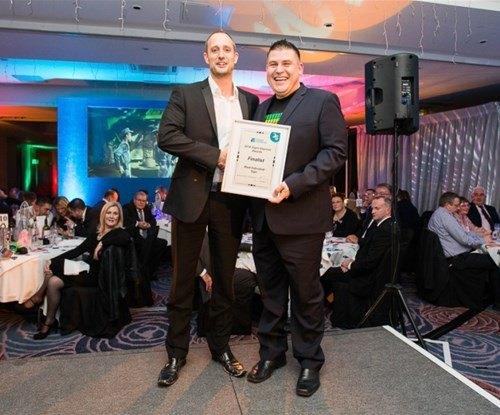 Warrington franchisee David Morris accepting his finalist award from Signs Express managing director Craig Brown