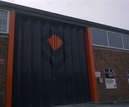 Branding graphics applied to a concertina door - Signs Express specified aluminium strips bonded to the door, leaving it to still open freely