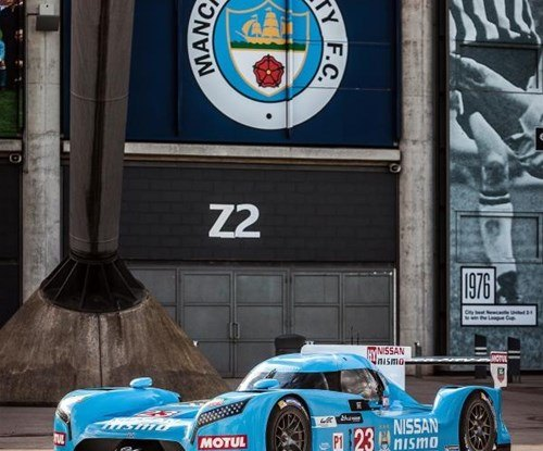 Vehicle wrap in Manchester City's colours